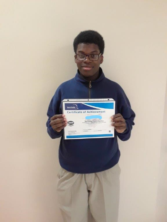 Student with ServSafe certificate.
