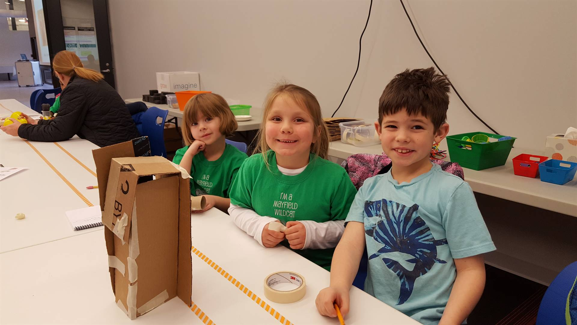 3 students showing building