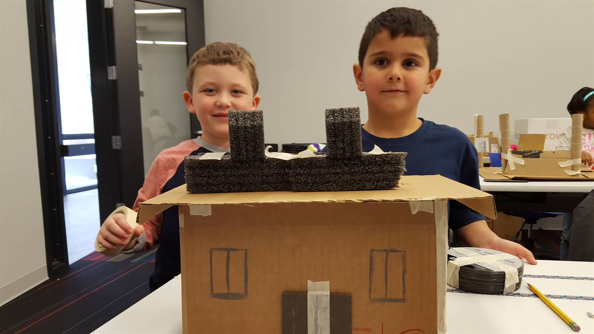 2 students with building
