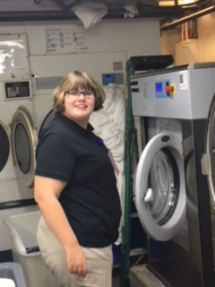 Student working at washing machine.